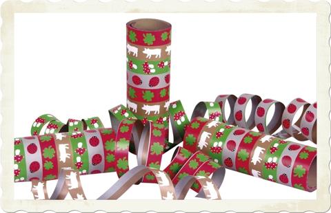 Luftschlangen mit Glückssymbolen zu Silvester